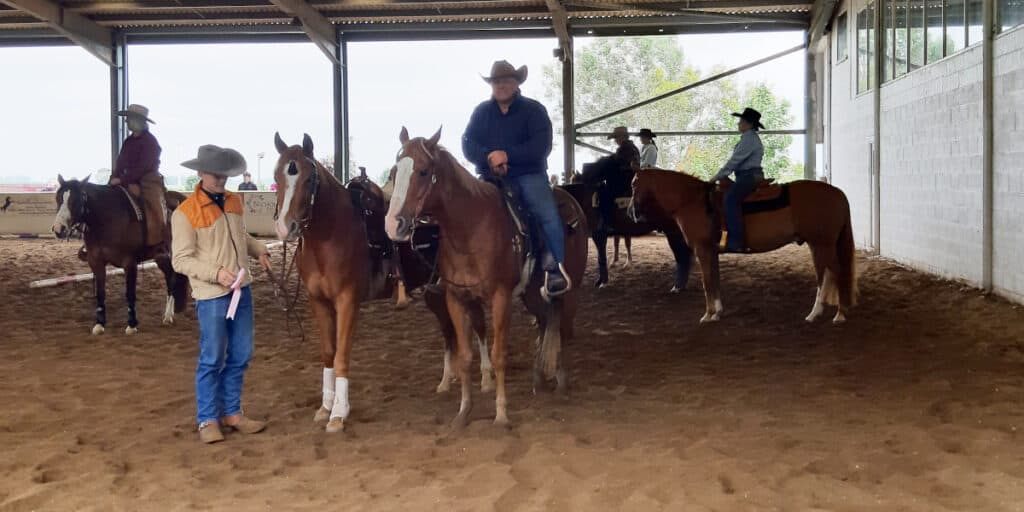 Luke de Cort and Cowboy with Dad, Neil and Tango after claiming his pink rosette